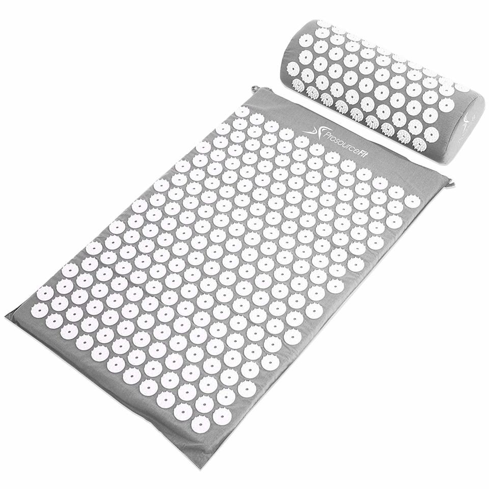"""<p>This mat and pillow combo contains hundreds of spike-like nodes for pinpointed pressure on your back, neck, and head to address aches and pains. Use it before crawling into bed to help alleviate soreness.</p> <p><strong>To buy:</strong> $20; <a href=""""https://www.amazon.com/ProSource-Acupressure-Pillow-Relief-Relaxation/dp/B00N24PK6A/ref=as_li_ss_tl?ie=UTF8&linkCode=ll1&tag=rslifesleepbetterrsylvester1019-20&linkId=8cd82998feefac6abf49ad8c6ea577a9&language=en_US"""" target=""""_blank"""">amazon.com</a>.</p>"""