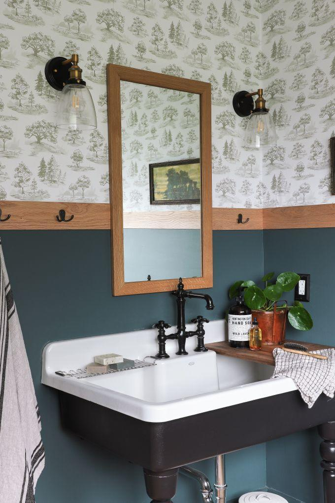 """<p>If you want your toile wallpaper paper to pop, pair it with colorful wainscoting. This setup from <a href=""""https://www.instagram.com/ispydiy/"""" rel=""""nofollow noopener"""" target=""""_blank"""" data-ylk=""""slk:Jenni Yolo"""" class=""""link rapid-noclick-resp"""">Jenni Yolo</a> masters the look.</p><p><em>Tree Toile, from $40 <br></em><a class=""""link rapid-noclick-resp"""" href=""""https://chasingpaper.com/wallpaper/tree-toile/"""" rel=""""nofollow noopener"""" target=""""_blank"""" data-ylk=""""slk:Shop the Look"""">Shop the Look</a></p>"""