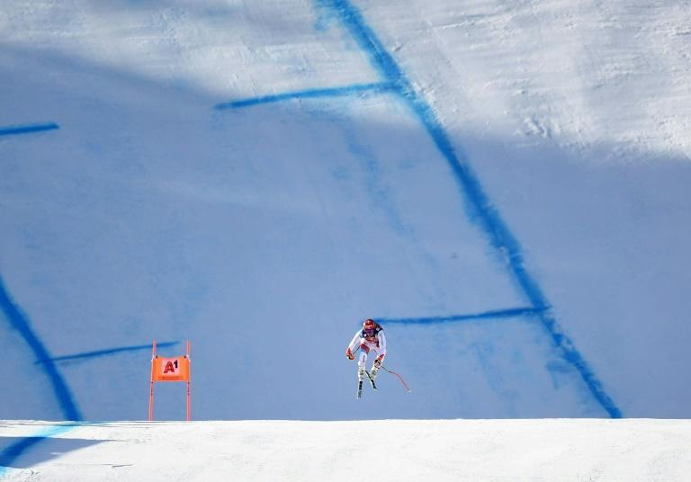 On the limit: Beat Feuz took to the air as he won at Kitzbuehel