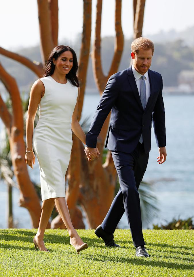 "<p>While it looked like a rather unassuming ivory design, the frock by Australian designer Karen Gee is actually called the ""Blessed Dress"" – which is a feeling we're sure rings true for the excited parents to be. Photo: AAP </p>"