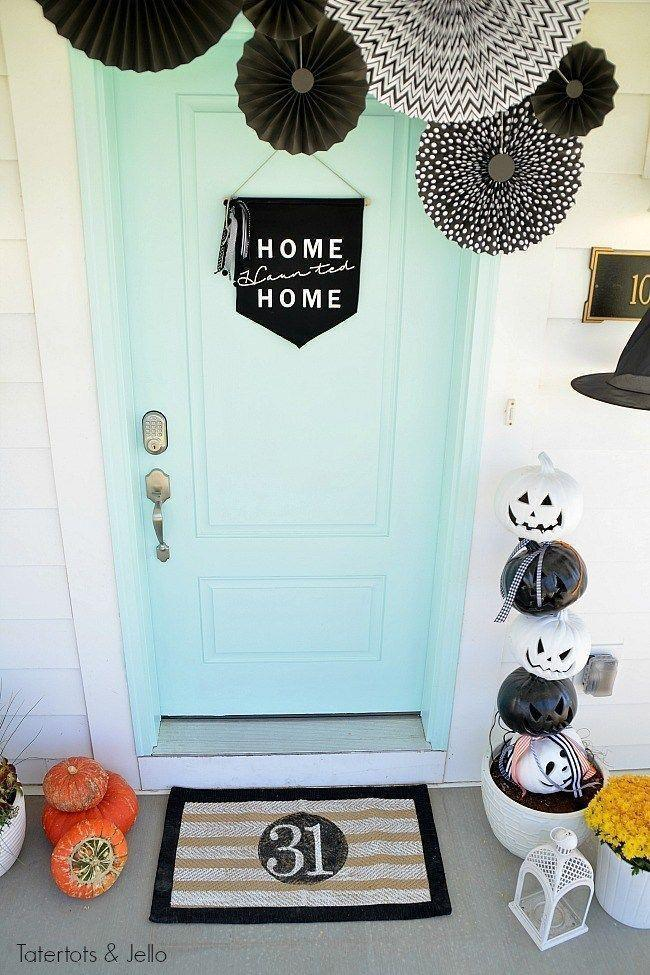 """<p>Elevate your entire porch by taking a few cues from this elegant front door. A """"Home Haunted Home"""" sign and black-and-white pumpkin skulls are two of our favorite elements here.</p><p><strong>Get the tutorial at <a href=""""https://tatertotsandjello.com/witching-hour-halloween-porch-ideas/"""" rel=""""nofollow noopener"""" target=""""_blank"""" data-ylk=""""slk:Tatertots + Jello"""" class=""""link rapid-noclick-resp"""">Tatertots + Jello</a>.</strong></p><p><strong><a class=""""link rapid-noclick-resp"""" href=""""https://go.redirectingat.com?id=74968X1596630&url=https%3A%2F%2Fwww.walmart.com%2Fsearch%2F%3Fquery%3Ddoormat&sref=https%3A%2F%2Fwww.thepioneerwoman.com%2Fholidays-celebrations%2Fg32894423%2Foutdoor-halloween-decorations%2F"""" rel=""""nofollow noopener"""" target=""""_blank"""" data-ylk=""""slk:SHOP DOORMATS"""">SHOP DOORMATS</a></strong></p>"""