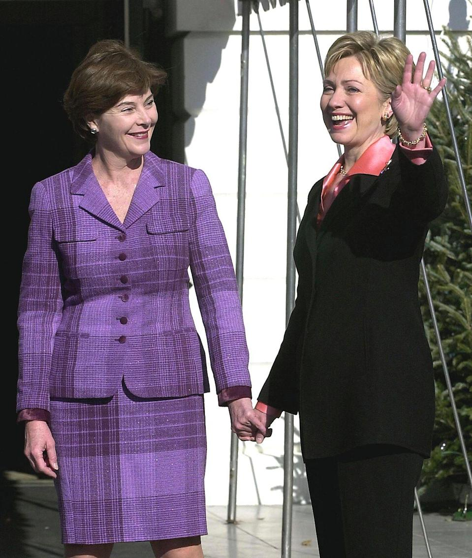 <p>First Lady Hillary Clinton waves as she greets future First Lady Laura Bush at the White House on December 18, 2020.</p>