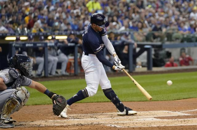 Milwaukee Brewers' Ryan Braun hits an RBI double during the first inning of a baseball game against the San Diego Padres Thursday, Sept. 19, 2019, in Milwaukee. (AP Photo/Morry Gash)