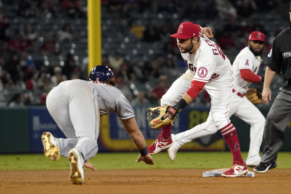 Houston Astros' Jake Meyers, left, steals second as Los Angeles Angels third baseman David Fletcher waits for a the ball that ended up going over his head during the fifth inning of a baseball game Thursday, Sept. 23, 2021, in Anaheim, Calif. (AP Photo/Mark J. Terrill)