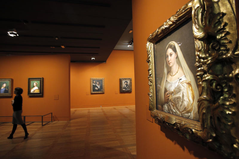 """"""" La Donna Velata """", a painting by Raphael on display as part of the exhibition """"Late Raphael"""" at the Louvre museum, in Paris, Tuesday, Oct. 9, 2012. This exhibition, organized by the Louvre from Oct. 11 to Jan. 14, 2013 in partnership with the Prado Museum, brings together the works produced by Raphael in Rome during the last years of his life. (AP Photo/Christophe Ena"""