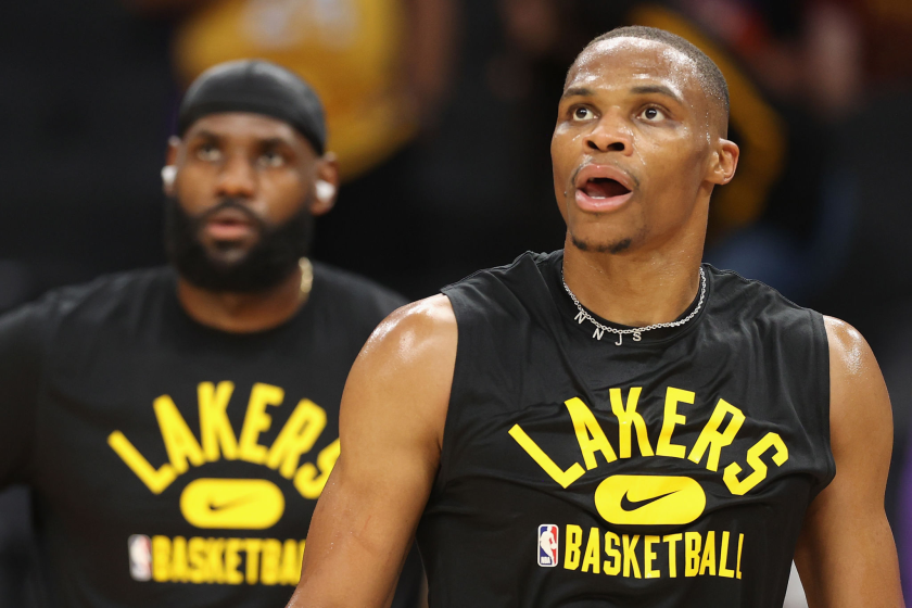 PHOENIX, ARIZONA - OCTOBER 06: Russell Westbrook #0 and LeBron James #6 of the Los Angeles Lakers warm up.