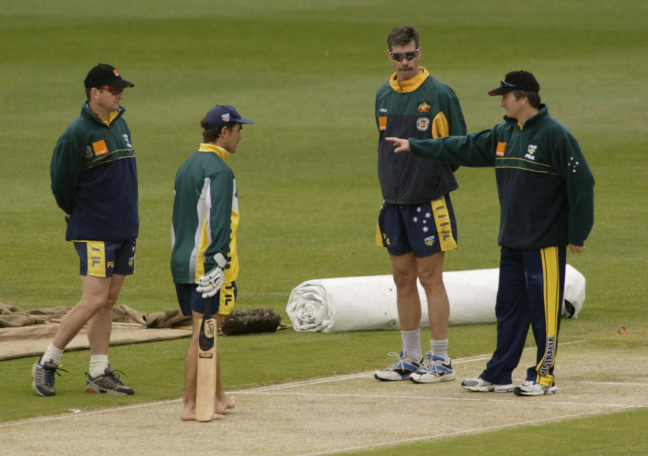 25 Dec 2001:  Mark Waugh, Justin Langer, John Buchanan and Steve Waugh of Australia inspect the pitch, during training at the Melbourne Cricket Ground, Melbourne, Australia. DIGITAL IMAGE. Mandatory Credit: Hamish Blair/Getty Images