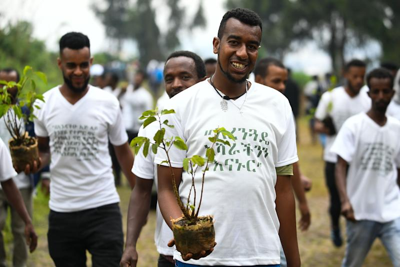 Ethiopians help plant trees in Addis Ababa. (Photo: Michael Tewelde/AFP/Getty Images)