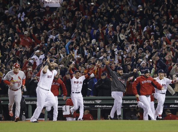 Boston Red Sox players rush onto the field after defeating the St. Louis Cardinals in Game 6 of baseball's World Series Wednesday, Oct. 30, 2013, in Boston. The Red Sox won 6-1 to win the series. (AP Photo/Elise Amendola)