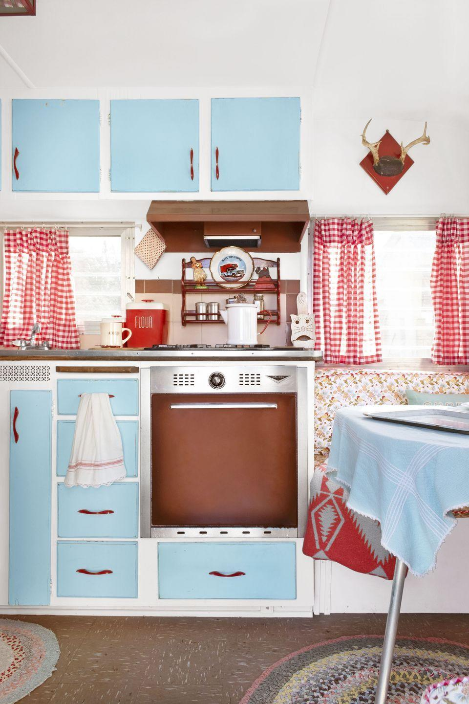"""<p>A small camper kitchen goes from blah to easy-breezy thanks to a little spray paint on the cabinets. Design House at Luckett's Store co-owner Amy Whyte spiffed up the kitchen with gingham, red pulls, and a can or two of <a href=""""https://go.redirectingat.com?id=74968X1596630&url=https%3A%2F%2Fwww.homedepot.com%2Fp%2FRust-Oleum-Stops-Rust-12-oz-Protective-Enamel-Gloss-Light-Turquoise-Spray-Paint-284678%2F205585924&sref=https%3A%2F%2Fwww.popularmechanics.com%2Fhome%2Fg37190959%2Fpaint-colors-small-rooms%2F"""" rel=""""nofollow noopener"""" target=""""_blank"""" data-ylk=""""slk:Rust-Oleum Turquoise"""" class=""""link rapid-noclick-resp"""">Rust-Oleum Turquoise</a>. <br></p>"""