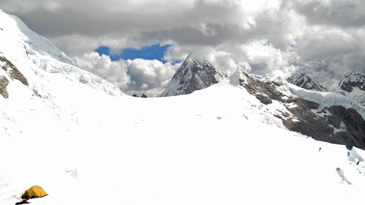 In this Thursday, July 26, 2012 photo released by Peru's police, a yellow tent believed by authorities to belong to U.S. climbers Gil Weiss and Ben Horne, sits near Palcaraju Peak in Huaraz, Peru. A search team reached the climbers' base camp and spotted the apparent tracks of the two 29-year-old U.S. mountaineers who have not been heard from since July 11 when they set off to climb the glacier-capped peak in the Cordillera Blanca range of northern Peru. Weiss and Horne are experienced climbers from Boulder, Colorado. (AP Photo/Peru Police)