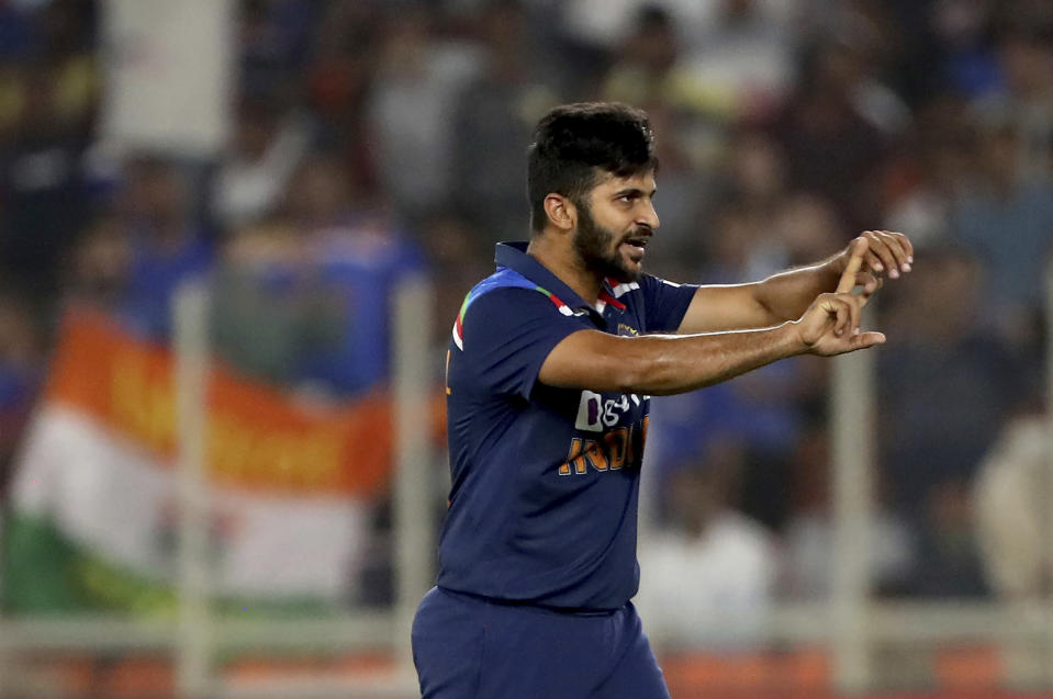 India's Shardul Thakur celebrates the dismissal of England's Ben Stokes during the third day of fourth cricket test match between India and England at Narendra Modi Stadium in Ahmedabad, India, Saturday, March 6, 2021. (AP Photo/Aijaz Rahi)