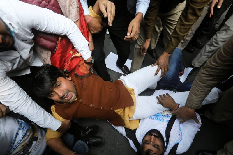 A supporter of India's main opposition Congress party reacts as he is detained along with party supporters outside the party headquarters, in New Delhi