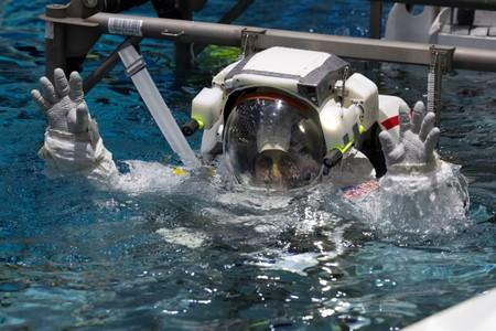NASA Commercial Crew astronaut Sunita Williams is lowered into the water at NASA's Neutral Buoyancy Laboratory (NBL) training facility near the Johnson Space Center in Houston