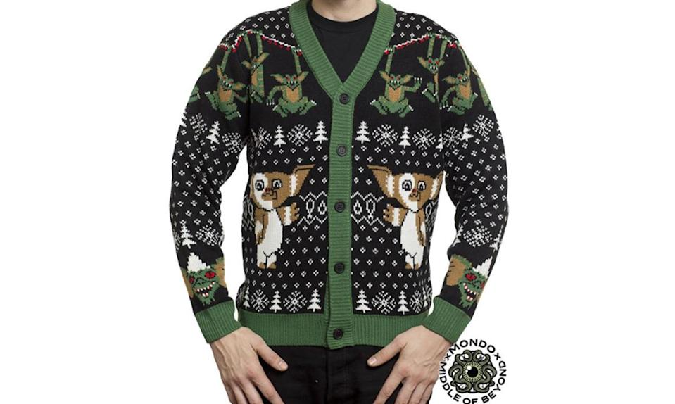 """<p>Some people like pullovers. But for those whose ugly pop culture Christmas sweater tastes lean towards the cardigan, here ya go. <strong><a rel=""""nofollow noopener"""" href=""""https://middleofbeyond.com/products/gremlins-cardigan"""" target=""""_blank"""" data-ylk=""""slk:Buy here"""" class=""""link rapid-noclick-resp"""">Buy here</a></strong> </p>"""