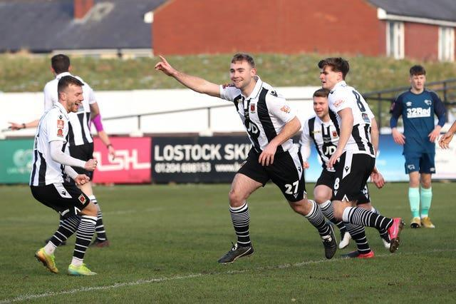 Connor Hall celebrates scoring Chorley's opening goal against Derby.