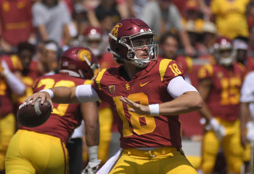 FILE - In this Sept. 1, 2018, file photo, Southern California quarterback J.T. Daniels passes during the first half of an NCAA college football game against UNLV in Los Angeles. Southern California quarterback J.T. Daniels is still working hard to become the elite passer many expected to see in his freshman season. Daniels is eighth in the Pac-12 with 1,788 yards passing, and he has just nine touchdown passes against seven interceptions for the 5-4 Trojans. Daniels is determined to have a big finish that could still get USC back to the Pac-12 title game. (AP Photo/Mark J. Terrill, File)