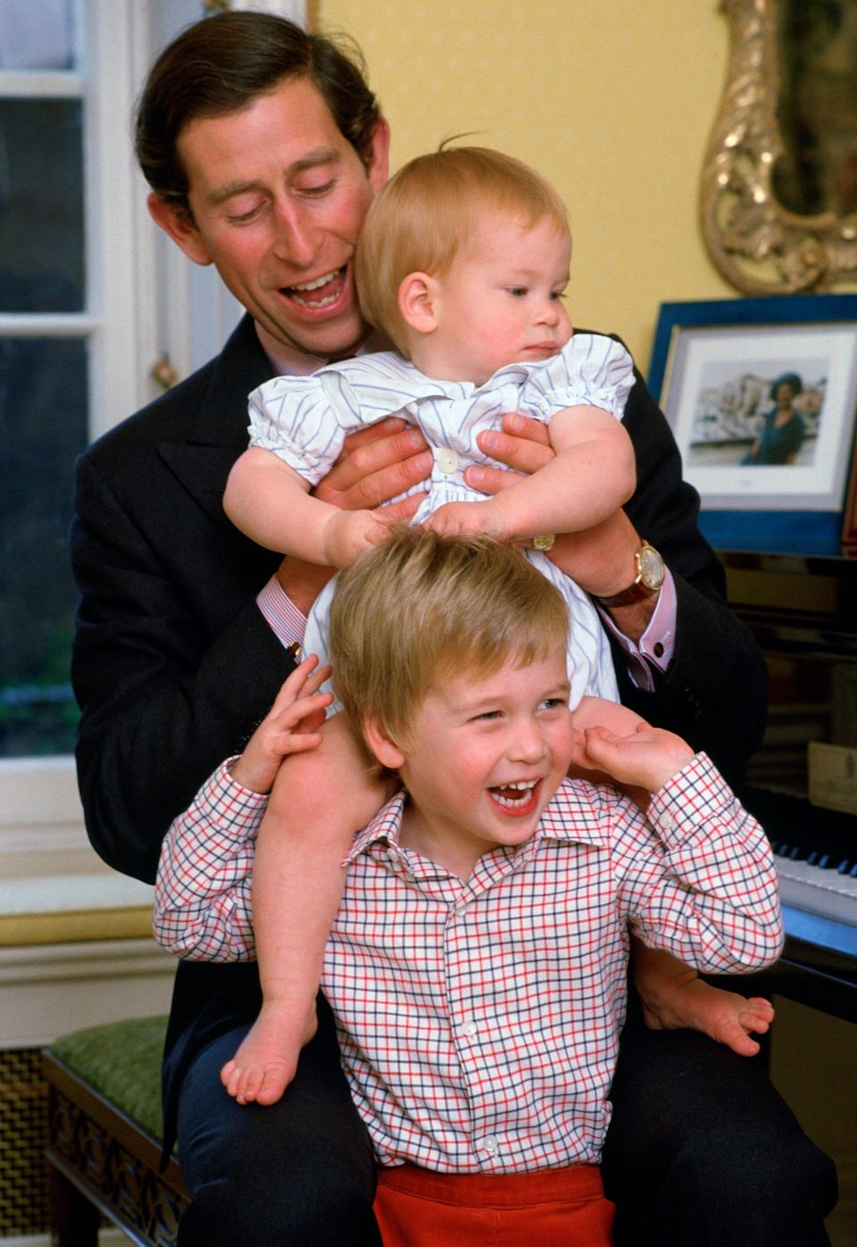 Prince Charles laughs with his young sons, Prince William and Prince Harry