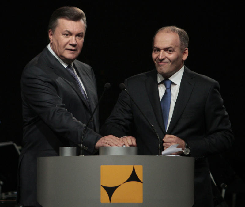 Ukraine's former president Viktor Yanukovych and tycoon Viktor Pinchuk take part in a ceremony to open a new steel mill on Oct. 4, 2012. (Anatolii Stepanov / Reuters)