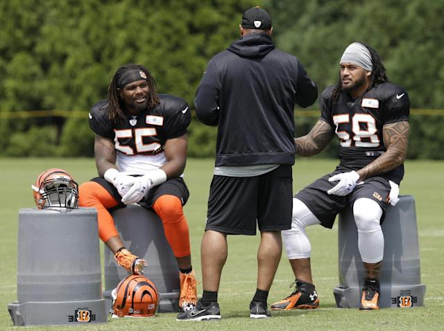 Cincinnati Bengals outside linebacker Vontaze Burfict (55) and middle linebacker Rey Maualuga (58) talk to a coach during practice at the NFL football team's training camp on Saturday, July 26, 2014, in Cincinnati. (AP Photo/Al Behrman)