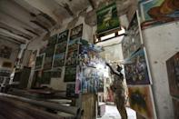 An artist displays his paintings at the former colonial shippers' office in Grand-Bassam