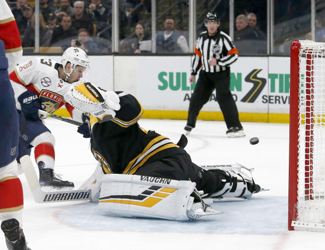 Florida Panthers right wing Evgenii Dadonov (63) scores past Boston Bruins goaltender Tuukka Rask (40) during the first period of an NHL hockey game, Saturday, March 30, 2019, in Boston. (AP Photo/Mary Schwalm)