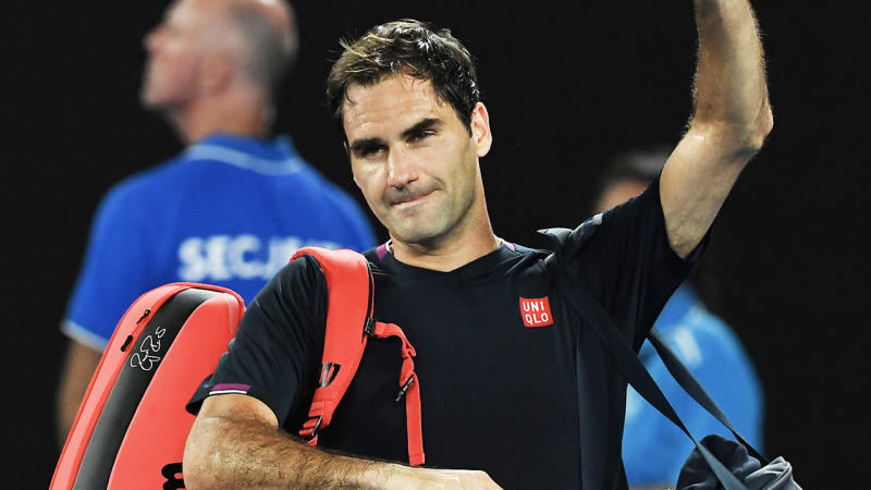 Roger Federer waves goodbye to the crowd.