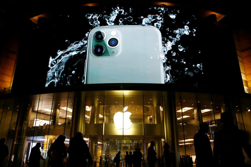 FILE PHOTO: Screen displaying an advertisement for iPhone 11 Pro is seen outside an Apple store in Beijing