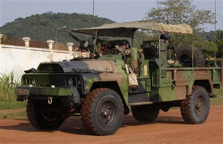 French soldiers are seen on their military vehicle at the Miskine district in Bangui December 10, 2013. REUTERS/Emmanuel Braun