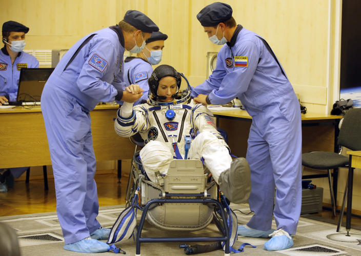 <p>Russian Space Agency experts help U.S. astronaut Kate Rubins, member of the main crew to the International Space Station (ISS), to sit while inspecting her space suit prior to the launch of Soyuz-FG rocket at the Russian leased Baikonur cosmodrome, Kazakhstan, Thursday, July 7, 2016. (AP Photo/Dmitri Lovetsky) </p>