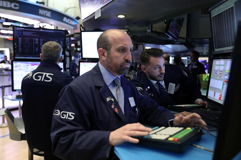 Traders work on the floor at the New York Stock Exchange (NYSE) in New York, U.S., May 6, 2019. REUTERS/Brendan McDermid