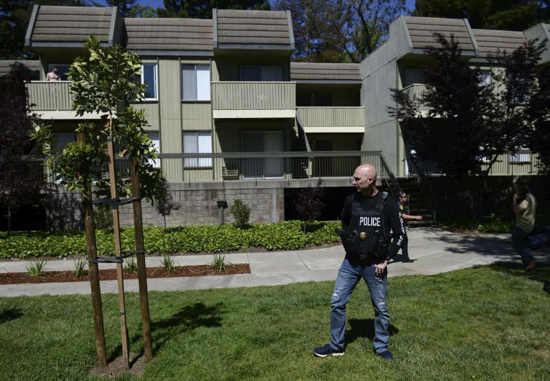 Police work the apartment complex believed to be associated with a car crash suspect in Sunnyvale, Calif., on Wednesday, April 24, 2019. Investigators are working to determine the cause of a crash in Northern California that injured eight pedestrians on Tuesday evening. Authorities say the driver of a car was taken into custody after he appeared to deliberately plow into them. (AP Photo/Cody Glenn)