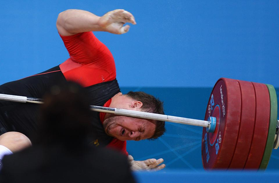 LONDON, ENGLAND - AUGUST 07: Matthias Steiner of Germany lies on the floor after failing to lift in the Men's +105kg Weightlifting final on Day 11 of the London 2012 Olympic Games at ExCeL on August 7, 2012 in London, England. (Photo by Lars Baron/Getty Images)