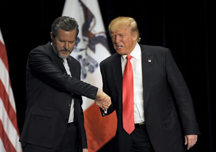 Donald Trump shakes hands with Jerry Falwell Jr., presidentof Liberty University, the nation's largest Christian university, during an Iowa campaign event, Jan. 31, 2016. (Photo: Dave Kaup/Reuters)