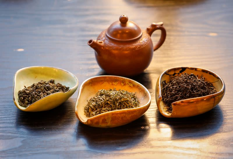 A view shows a pot and utensils with various types of tea leaves in a tea house in this picture illustration
