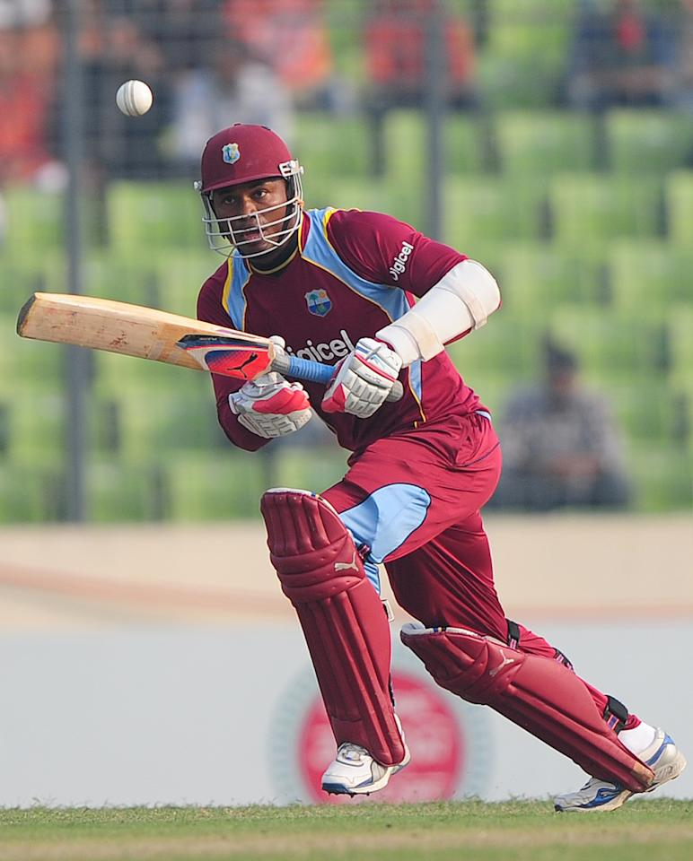 West Indies batsman Marlon Samuels plays a shot during the fourth one day international cricket match between Bangladesh and the West Indies  at the Sher-e-Bangla National Cricket Stadium in Dhaka on December 7, 2012. AFP PHOTO/ Munir uz ZAMAN
