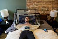 Mountaineer Francisco Martin is seen in a low-oxygen tent that mimics thin air at high altitude