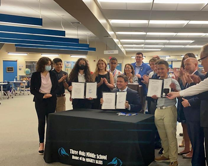 Gov. Ron DeSantis signs three bills into law at Three Oak Middle School in Fort Myers.