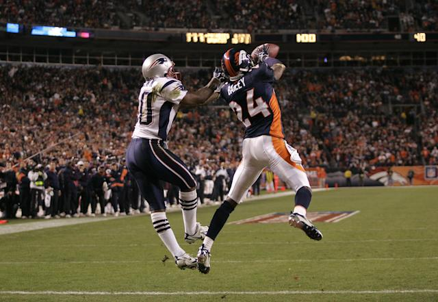 Cornerback Champ Bailey intercepts a Tom Brady pass in the end zone during a divisional round playoff game at the end of the 2005 season. (Getty Images)