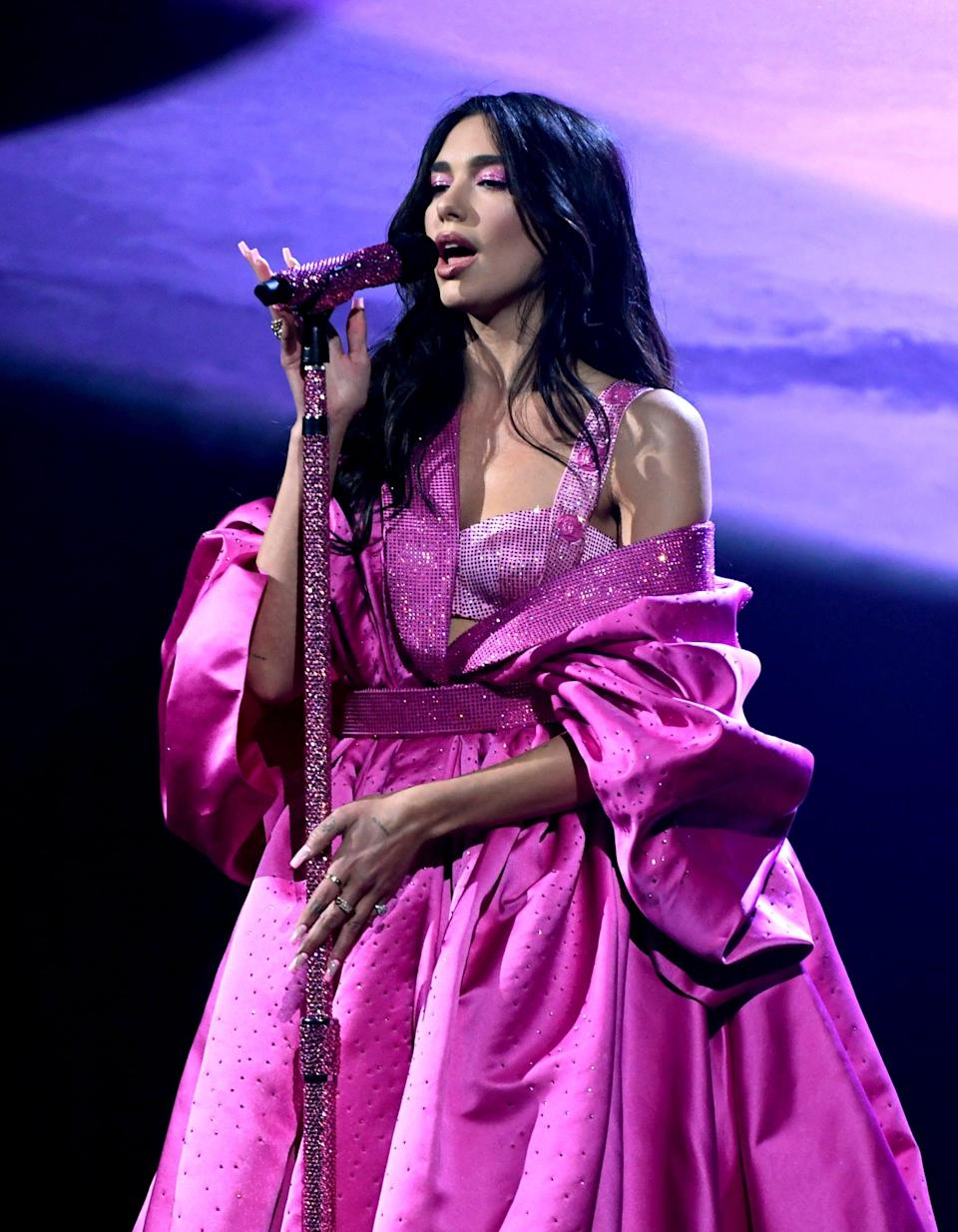 <p>Dua Lipa performed in a custom Atelier Versace gown fit for a princess.</p>