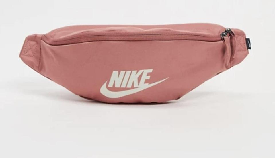 """<p>This <span>Nike Heritage Fanny Pack</span> ($25) will securely store your phone, keys, and wallet while you're on the go.</p> <p>Click <a href=""""https://www.popsugar.com/smart-living/Health-Wellness-Tips-46521311"""" class=""""link rapid-noclick-resp"""" rel=""""nofollow noopener"""" target=""""_blank"""" data-ylk=""""slk:here for more health and wellness stories, tips, and news"""">here for more health and wellness stories, tips, and news</a>.</p>"""