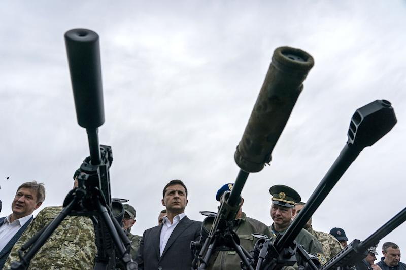 Volodymyr Zelenskiy, Ukraine's president, centre, inspects sniper rifles during an Interior Ministry military drill in Stare, Ukraine, on Sept. 30, 2019. Fallout from Donald Trump's phone call with Ukraine's leader is reverberating far beyond Washington. (Photo: Evgeniy Maloletka/Bloomberg via Getty Images)