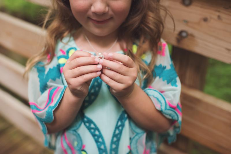 Adrianna showing off her necklace.  (Mandi Gilliland Photography)