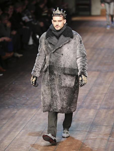 A model wears a creation for Dolce & Gabbana men's Autumn-Winter 2014 collection, part of the Milan Fashion Week, unveiled in Milan, Italy, Saturday, Jan. 11, 2014. (AP Photo/Antonio Calanni)