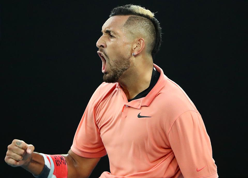 MELBOURNE, AUSTRALIA - JANUARY 27: Nick Kyrgios of Australia celebrates during his Men's Singles fourth round match against Rafael Nadal of Spain on day eight of the 2020 Australian Open at Melbourne Park on January 27, 2020 in Melbourne, Australia. (Photo by Kelly Defina/Getty Images)