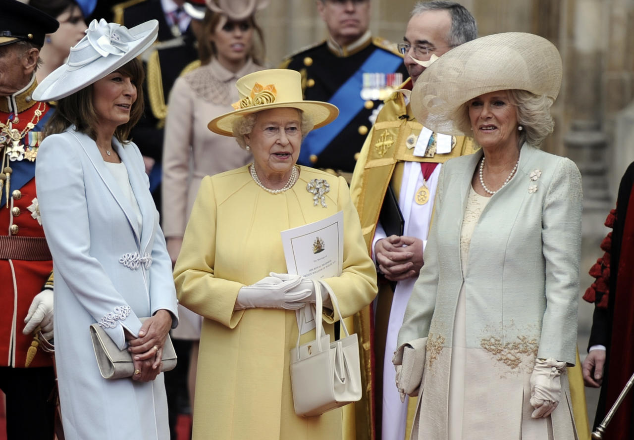 Britain's Queen Elizabeth II is flanked by Carole Middleton, left, and Camilla, Duchess of Cornwall outside of Westminster Abbey after the Royal Wedding in London Friday, April, 29, 2011.