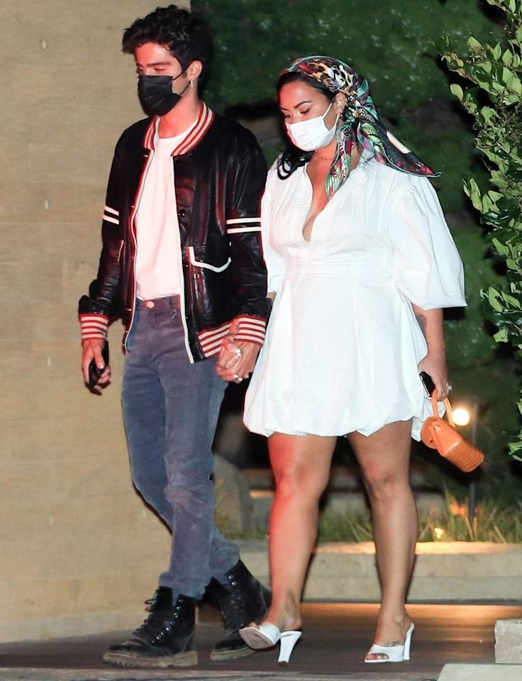 <p>Demi Lovato and fiancé Max Ehrich hold hands as they leave dinner at Nobu on Sunday.</p>