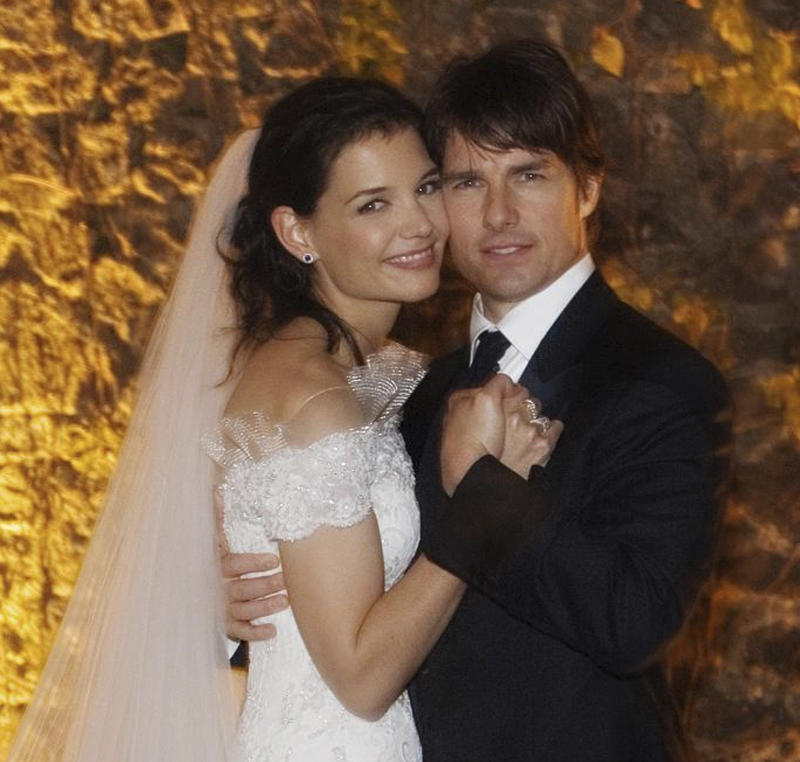 FILE - In this Nov. 18, 2006 file photo released by Rogers and Cowan, actor Tom Cruise and actress Katie Holmes pose in their wedding attire at the 15th-century Odescalchi Castle overlooking Lake Bracciano outside of Rome. Cruise and Homes are calling it quits after five years of marriage. Holmes' attorney Jonathan Wolfe said Friday June 29, 2012 that the couple is divorcing, but called it a private matter for the family.  (AP Photo/Robert Evans, File)