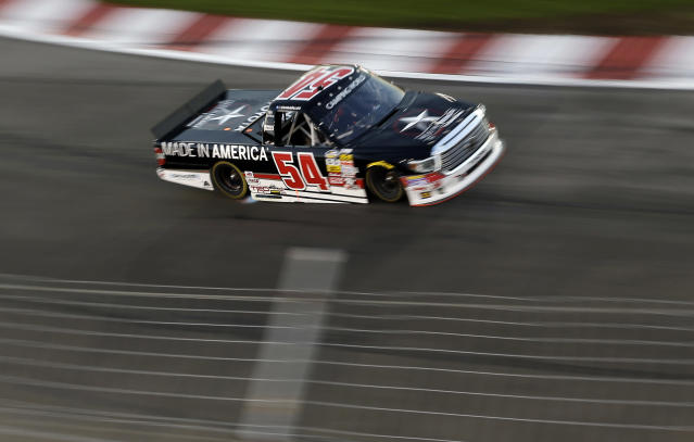 Darrell Wallace Jr. makes his way through Turn 1 during the NASCAR Truck Series auto race at Gateway Motorsports Park on Saturday, June 14, 2014, in Madison, Ill. (AP Photo/Jeff Roberson)