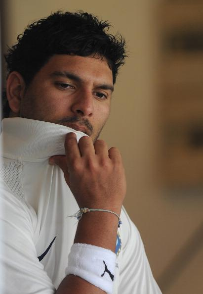 MUMBAI, INDIA - NOVEMBER 01:  Yuvraj Singh of India 'A' is seen outside the dressing room as he wiats to bat during the final day of the first practice match between England and India 'A' at the CCI (Cricket Club of India) ground, on November 1, 2012 in Mumbai, India.  (Photo by Pal Pillai/Getty Images)